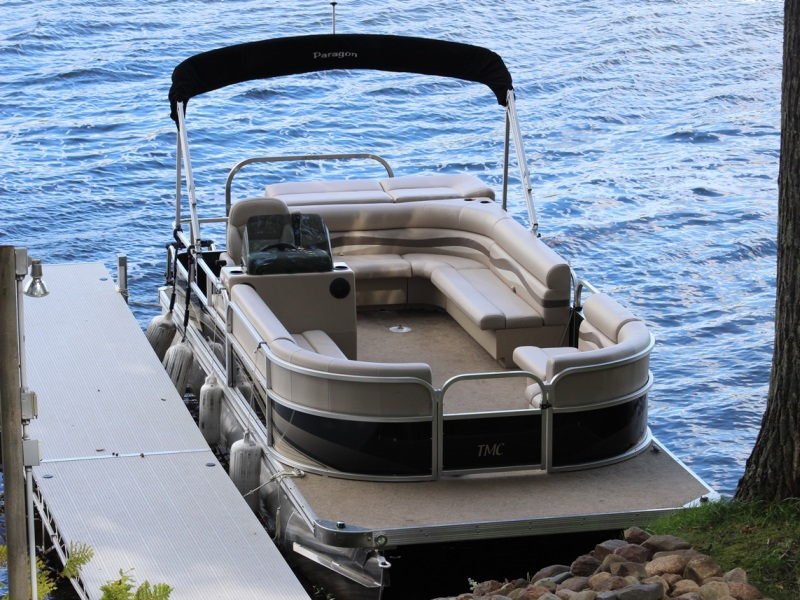 Tmc inc pontoons boats wisconsin minnesota for Used boat motors mn